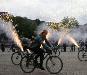 Image of gerb pyrotechnics firing from back of bikes
