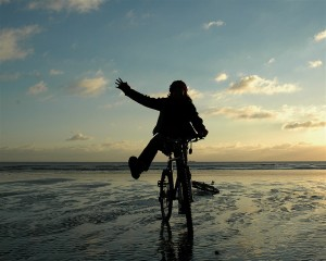 Karen on her bike, on low tide, sunset beach in Shoreham - the birth of an idea