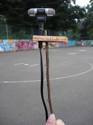 small microphone attached to a stick by a peg with Bicycle Ballet written on it