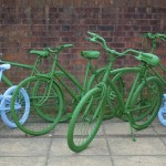painted bikes leaning against wall