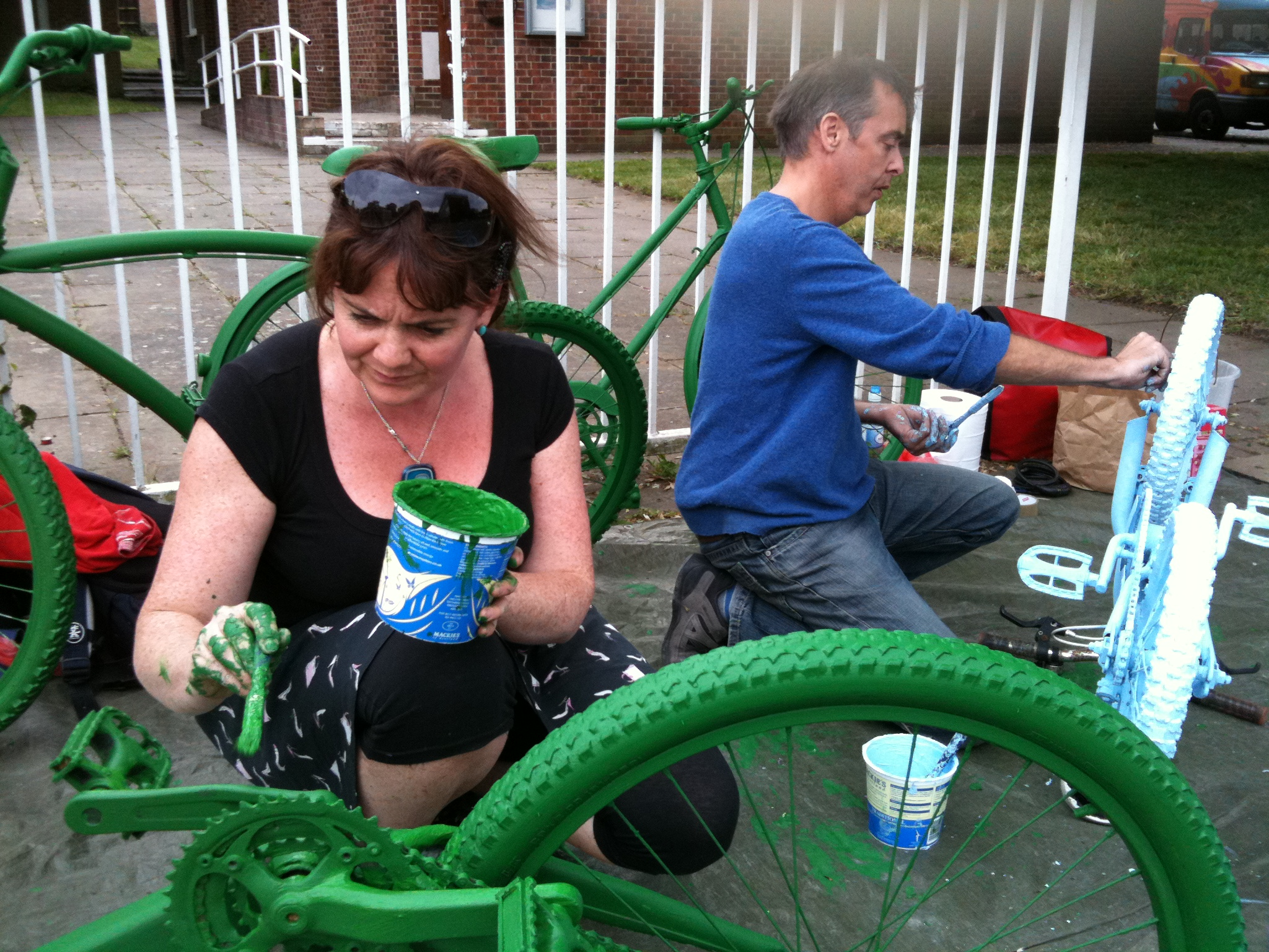 Maria and Ray paint bikes tree green and sky blue