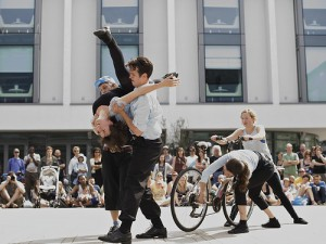 The crash scene.  Two performers lift Sarah in a somersault off her bike