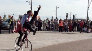 boy doing a scissor kick, jump over the handlebars of moving bike