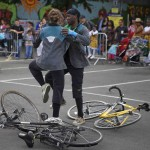 Two participants dance tango between two bikes lying on the ground