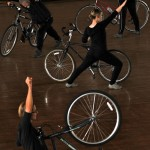 performers with their bikes strike a pose
