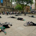 All performers and their bikes lie on the floor, after 'the crash'