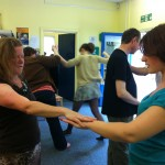 Participants work in pairs leading and following each others' movements