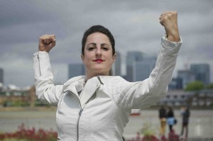 Sophie Arstall (Bravery) raises her arms, flexing her muscles