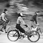 1950s women race along on bikes